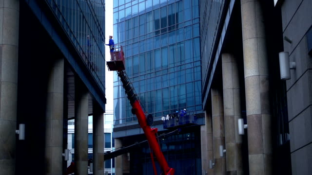 Windows cleaning in a downtown district video
