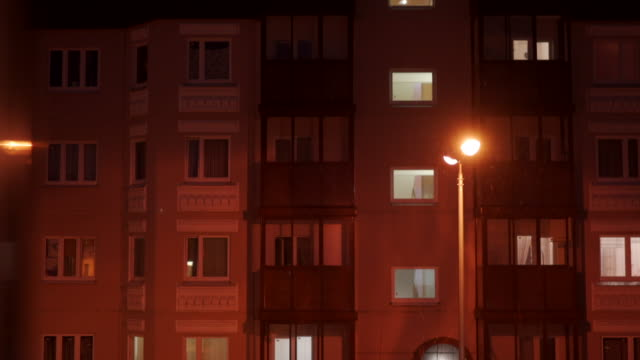 Windows of residential apartment building at dusk in winter