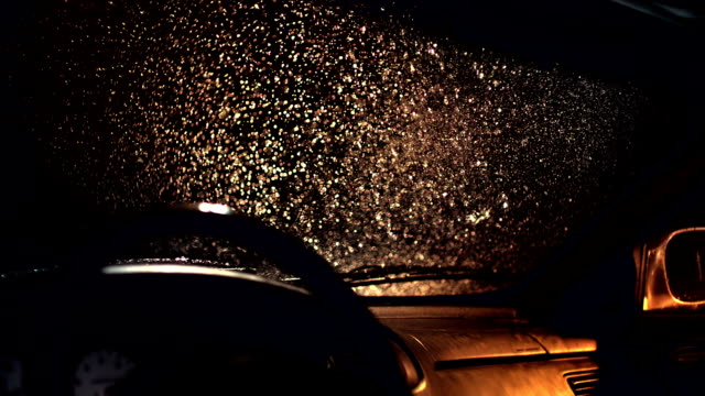Windshield wiper in rain at night, Slow Motion video