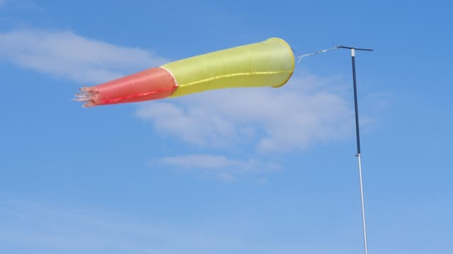windsock on wind against sky - rękaw filmów i materiałów b-roll