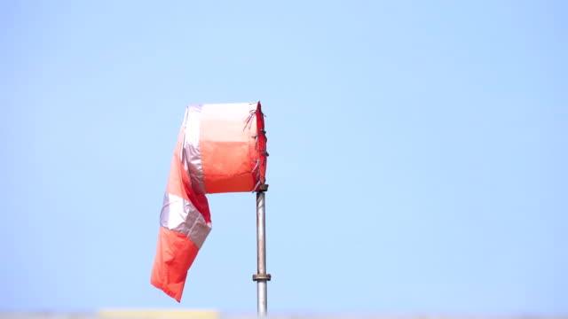 windsock showing the direction of wind at sky - rękaw filmów i materiałów b-roll