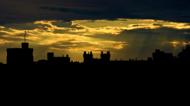 UK Windsor Castle cloudy sunset Windsor Castle is a medieval castle and royal residence in Windsor in the English county of Berkshire, notable for its long association with the British royal family and its architecture. It has been used by a succession of monarchs and is the longest-occupied palace in Europe. royalty stock videos & royalty-free footage
