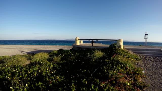 Windy day in Rhodes island sea coast, Greece Windy sunny day in Rhodes island sea coast, Greece aegean islands stock videos & royalty-free footage