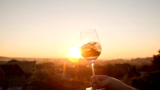 Wine Aroma Close up of a male's hand holding a crystal glass of white wine. winetasting stock videos & royalty-free footage