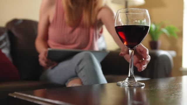 vídeos de stock e filmes b-roll de wine at home alone - coffee table