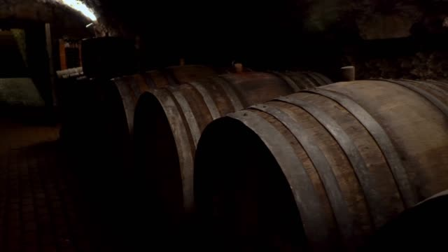 Wine barrels stacked in a old cellar at winery
