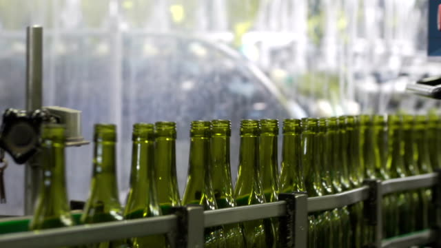 Wine bottles in a wine bottling factory of South France video