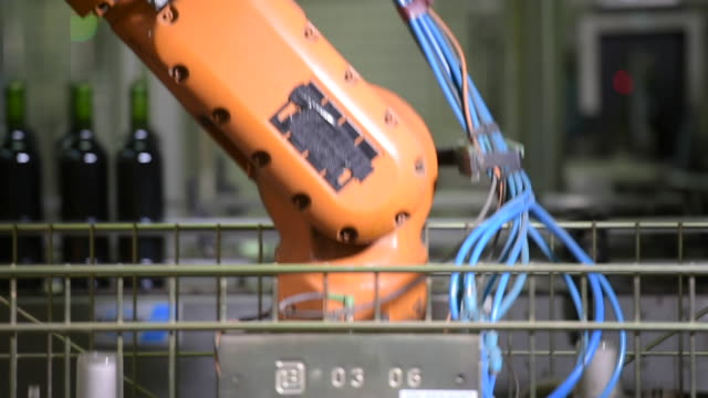 Wine bottles in a wine bottling factory-Robot in action video