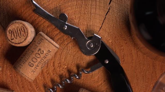 Wine corks, bottle, glass on wood background video
