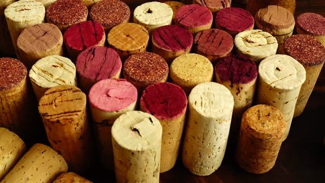 Wine corks on a wooden board. Wine corks on a wooden board. cork stopper stock videos & royalty-free footage