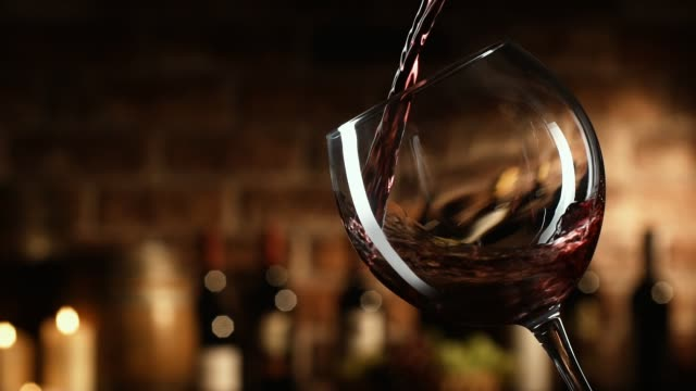 Wine expert pouring red wine in a glass Sommelier tasting wine in the cellar, he is pouring an excellent red wine in a glass red wine stock videos & royalty-free footage