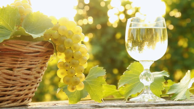 HD DOLLY: Wine Glass And Basket Of Grapes video