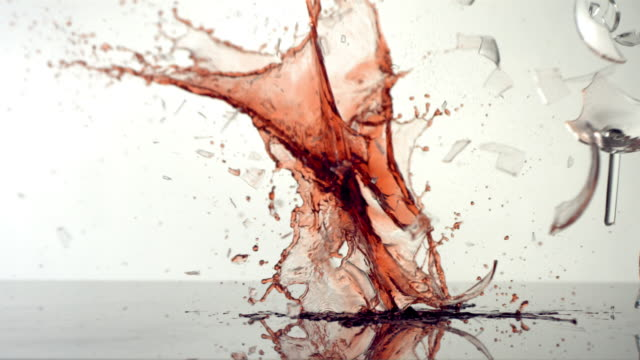 Wine glass breaking, slow motion video