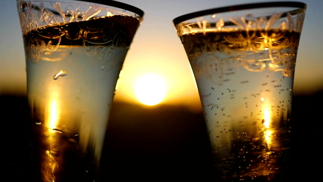 wine glasses clink at sunset video