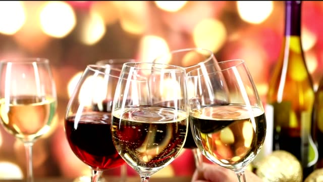 Wine glasses clinking in slow motion