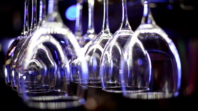 wine glasses hanging above the bar video