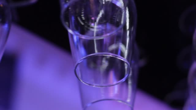 Wine glasses hanging upside down above a bar rack