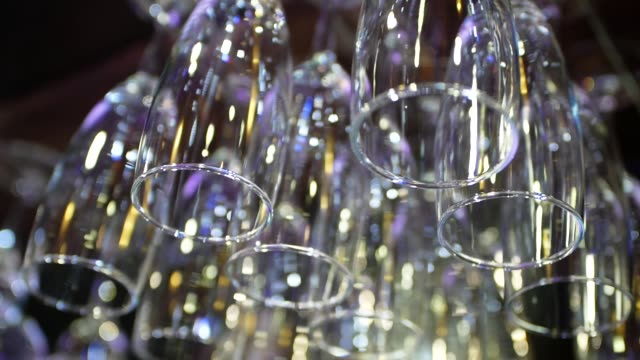 Wine glasses hanging upside down above the bar.