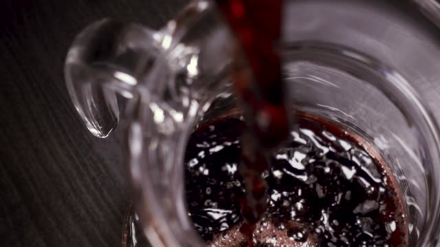 wine is poured into the carafe from above - decanter video stock e b–roll