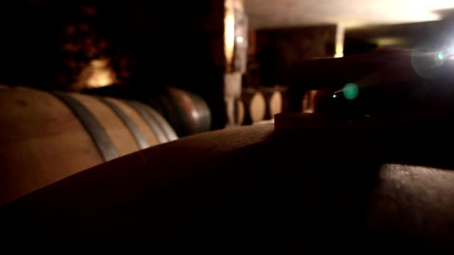 Wine maker removes and applies topper to a wine barrel video