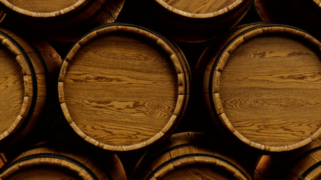 vídeos de stock e filmes b-roll de wine or whiskey barrels stacked at the winery. looped animation. - barrica