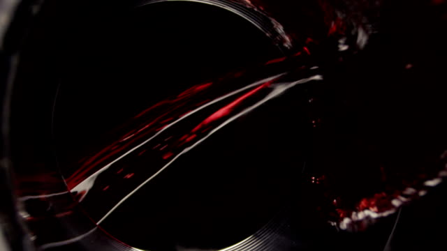 Wine poring Wine poring. Slow motion. red wine stock videos & royalty-free footage