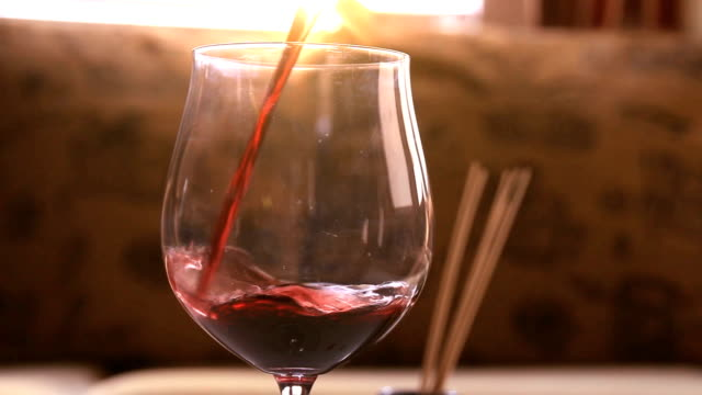 wine pouring into a wine glass - tracking shot video