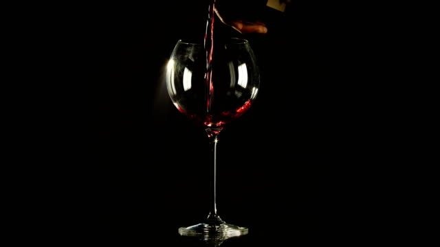 Wine waiter pouring red wine bottle in burgundy glass video