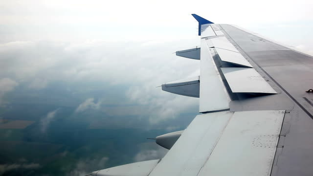 Wing of plane flying in the clouds video