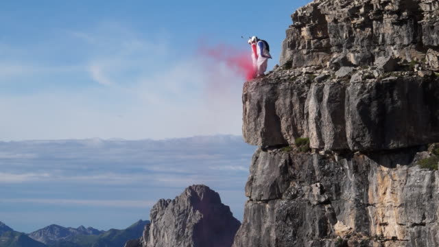 wingsuit pilots jump off cliff - base jumping video stock e b–roll