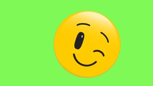 vídeos de stock e filmes b-roll de winking face emoji - piscar