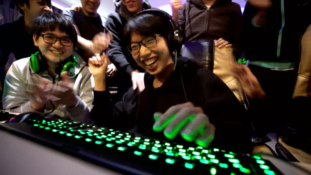 Winning in eSports games with gamer friends Winning in eSports games with gamer friends in internet cafe. contest stock videos & royalty-free footage