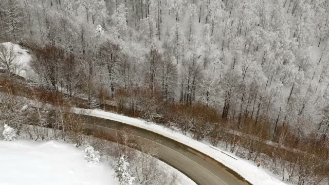 Winter aerial view above the mountain road video