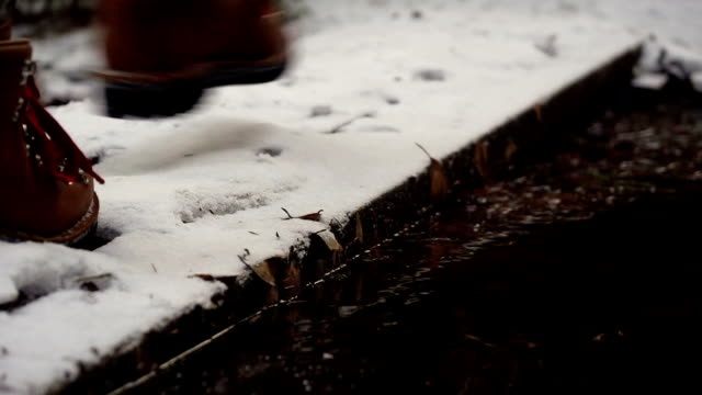 winter boots on snowy road in the forest video