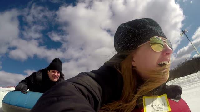 stockvideo's en b-roll-footage met winter einden - snow tubing fun - opblaasband