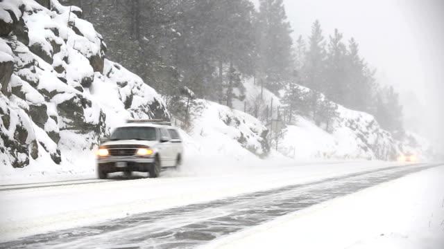 vídeos de stock e filmes b-roll de winter driving hazardous snow blizzard conditions - passagem de ano