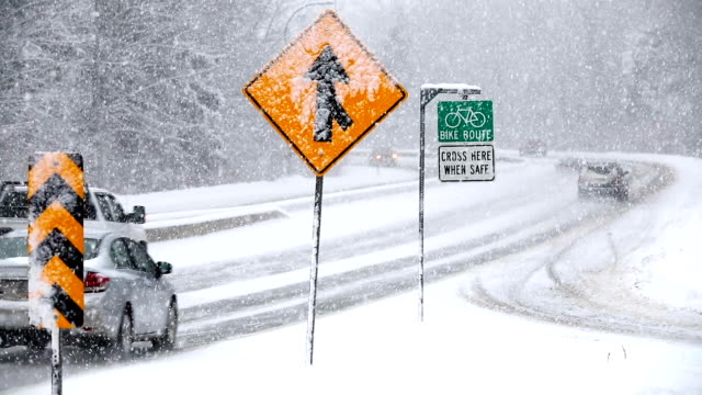 winter driving snow blizzard - road signs stock videos and b-roll footage