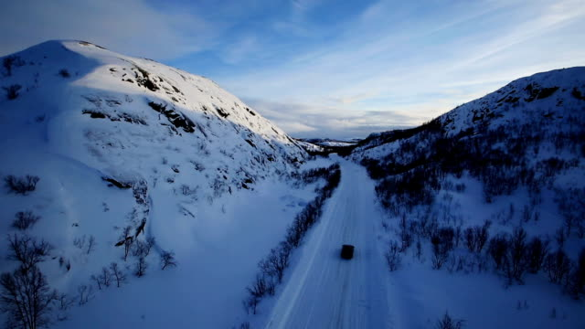 Winter Driving - Winter Road Country road leading through a winter mountain landscape video