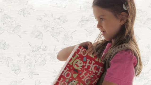 Winter Holiday Traditions. Christmas Giving a Present video