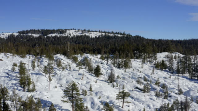 Winter in mountains. Aerial drone footage. California.