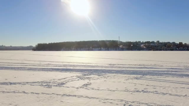 Winter landscape. Beautiful view of the winter city and the lake from a bird's-eye view video