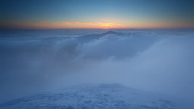 Winter mountain at sunset over clouds - time lapse video video