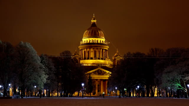 Winter night, Saint Isaac's Cathedral against dark park, view from Senate Square video