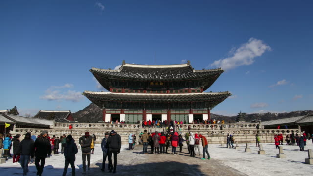 Winter scenery hyper lapse of people touring Korea Gyeongbokgung Palace. Winter scenery hyper lapse of people touring Korea Gyeongbokgung Palace. gyeongbokgung stock videos & royalty-free footage