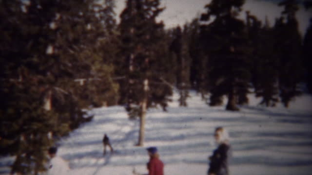 1940: Winter snow skiing T-bar chairlift ride up mountain. video