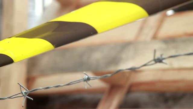 winter wind yellow tape barbed wire, do not cross sign - på gränsen bildbanksvideor och videomaterial från bakom kulisserna