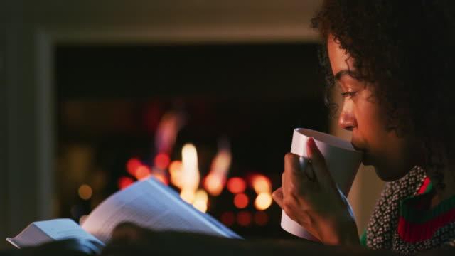 winter's here, keep it cozy - уютный стоковые видео и кадры b-roll