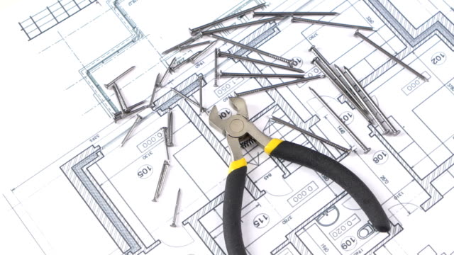 Wire cutters with yellow, gray handle on building plan, scheme, among nails, rotation Open wire cutters with yellow and gray handle, silver, isolated on building plan, scheme among nails, rotation wrench stock videos & royalty-free footage