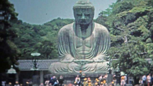 SINGAPORE 1973: Wise Siddhartha Gautama Buddha statue in Asia tourist visits. video