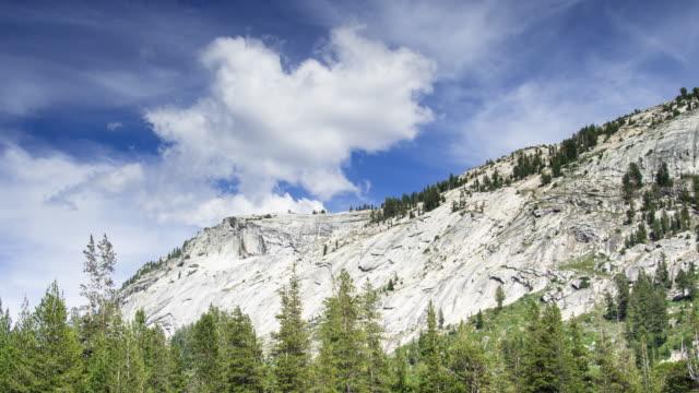 Wispy Clouds Over Granite Yosemite Hillside - Time Lapse video